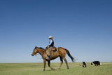 A Cowboy Rides His Horse On a Ranch Near Fort Pierre