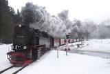 Meter-gauge 2-10-2T Steam Locomotive 99 7238-1 in a Snowy Landscape