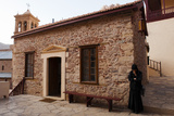A Nun Waits By a Small Meeting Building Within Saint Catherine's Monastery