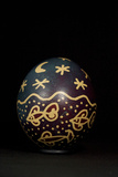 An Easter Egg Decorated with Fish Swimming Under a Stary Sky