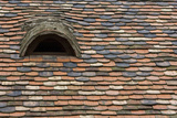 Detail of a Tile Roof with a Window in the Old Downtown