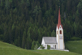 A Church Surrounded By Pine Trees in a Hillside Meadow