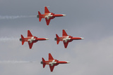 Bright Red Jets Flying in Formation At an Air Show
