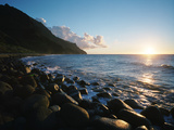 The  Rock-covered Kalalau Beach At Sunset