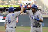 Minneapolis  MN - June 27: Mike Moustakas and Salvador Perez