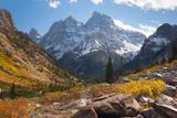 A High Canyon in Fall Foliage and Early Snow  and Snow Covered Peaks