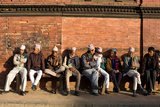 Local Men Sit on a Bench in Patan Durbar Square