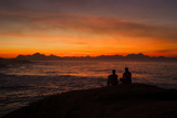 Early Risers Enjoy the Sunrise at Arpoador Rock Near Ipanema Beach