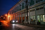 Headlights Shine From a Car Parked on a Deserted Street in Cienfuegos