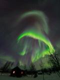 The Aurora Borealis Over a Sami Village House