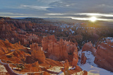 The Sun Rising Over Snow-dusted Hoodoos