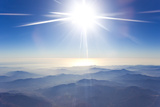 A High  Bright the Sun Over the Foggy Andes Mountains