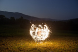 A Child Plays with Sparklers in a  Field in Lost Cove  Tennessee