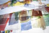 Buddhist Prayer Flags Hang From the Bodhnath Stupa