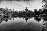 Bayon Temple and Lush Flora Cast a Mirror Reflection on Water