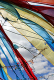 Colorful Tibetan Prayer Flags Fly Against a Blue Sky