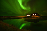 The Aurora Borealis Or Northern Lights Above a Hotel