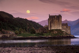 Eilean Donan Castle and Its Reflection on a Sea Loch Under Moonrise
