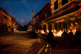 Diners Sit at a Candlelit Cafe on Bandipur's Main Street at Night