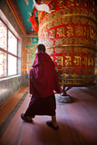 A Monk Spins the Worlds Largest Prayer Wheel Near Boudhanath Stupa