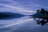 Loch Rannoch Casts a Mirror Reflection of Mountains  Sky  and Trees