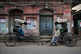 Rickshaw Pullers Pause for a Break on a Kolkata Side Street