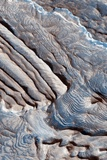 Periodic Layering in the Becquerel Crater on Mars