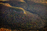 Aerial View of Old Mountains Covered in Forests of Autumn Hues