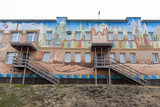 An Apartment Building Adorned with Colorful Murals