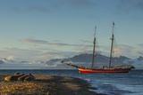 A Tall-masted Schooner  the Northern Light  Anchored Off a Beach