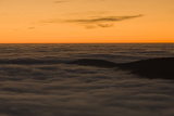 Mountain Tops in the Black Forest Break Through Fog at Sunrise