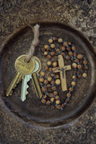 Three Brass Doorkeys Tied with String Lying Next To Rosary with Crucifix
