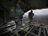 Soldiers Jump from a C-130 Aircraft Over Germany