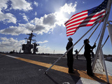 Sailors Shift the Colors Aboard the Aircraft Carrier USS Carl Vinson