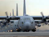 C-130 Hercules Aircraft Taxi Out For a Mission During a Six-ship Sortie