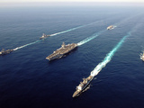 The Enterprise Carrier Strike Group Sails Through the Atlantic Ocean in Formation