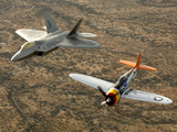 A World War II-era P-47 Thunderbolt And An F-22A Raptor Fly in Formation