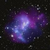 The Massive Galaxy Cluster MACS J0717