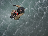 Airmen Are Hoisted Out of the Water During a Water Rescue Training Scenario