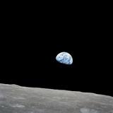 Earth Rising Above the Lunar Horizon