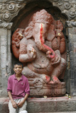 Nepalese Boy and Ganesh Statue