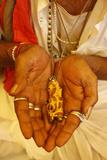 Sadhvi (Female Sadhu) Showing a Ganesh Pendant at the Kumbh Mela in Haridwar