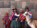 South America  Peru  Cusco Quechua People in Front of An Inca Wall  Holding a Lamb and a Llama