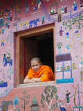 Monk at Window of the Reclining Buddha Sanctuary Aka the Red Chapel  Laos