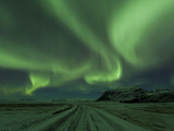 Northern Lights  Aurora Borealis  Winter Road With Snow  Iceland
