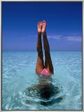 A Female Swimming in Crystal Clear Waters  Bahamas