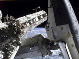 Space Shuttle Discovery Docked to the International Space Station