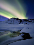 Aurora Borealis over Mikkelfjellet Mountain in Troms County  Norway