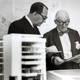 Charles Edouard Jeanneret  known as Le Corbusier (1887-1965) Discussing Architectural Plans  c1949