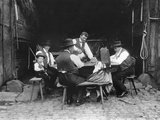 Alsatian Family Sitting at a Table in a Barn at Mietesheim  c1900